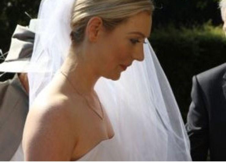 Rachel's delicately hand painted wedding dress