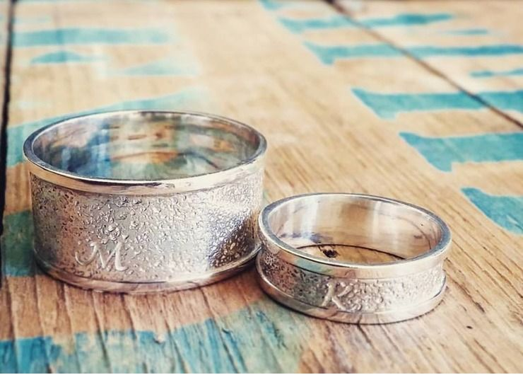 Custom Bands Embossed with Sand from the couple's own special beach.