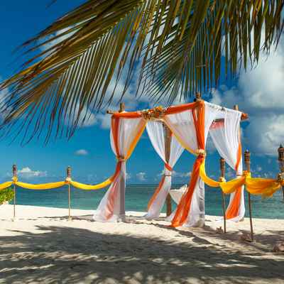 Beach yellow wedding ceremony decor