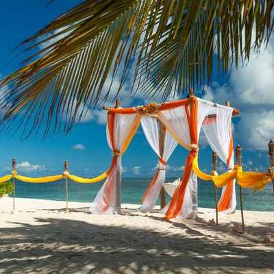 Beach yellow wedding ceremony decor