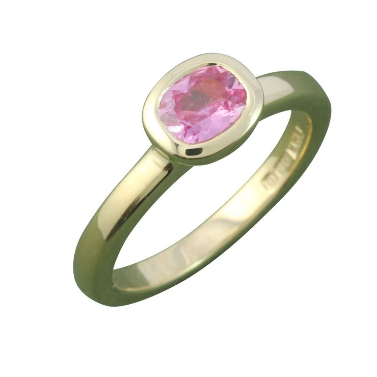 Pink sapphire and yellow gold ring