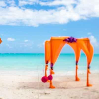 Beach orange wedding ceremony decor