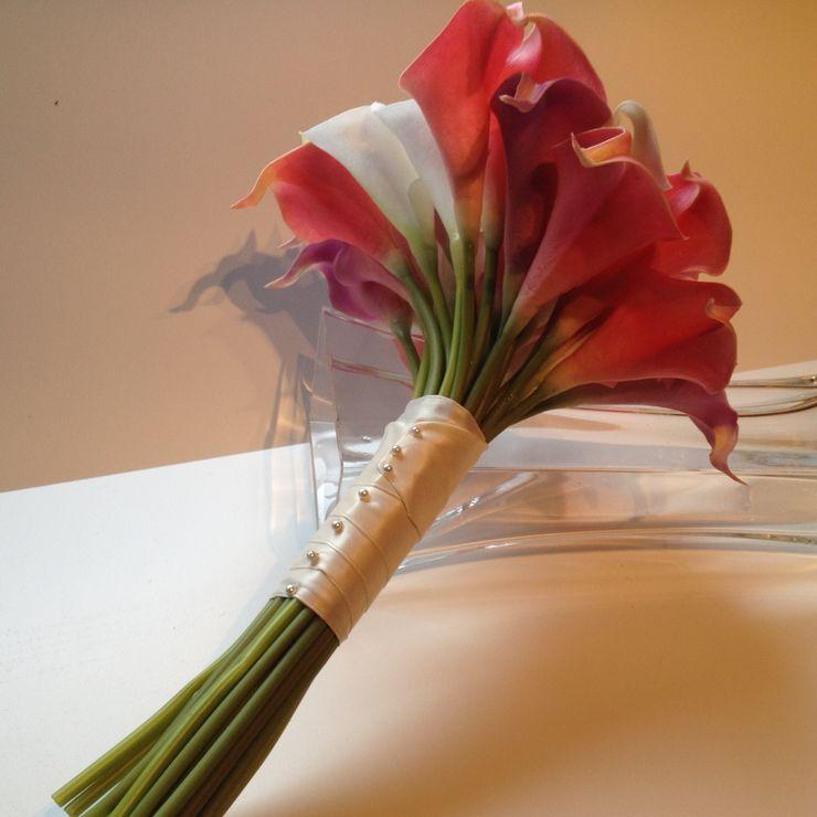 Beautiful replica Cala lily bouquet.