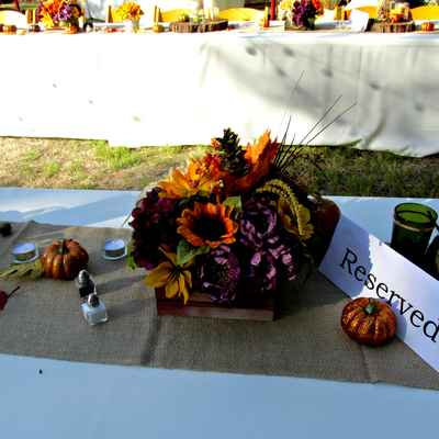 Outdoor autumn orange wedding reception decor