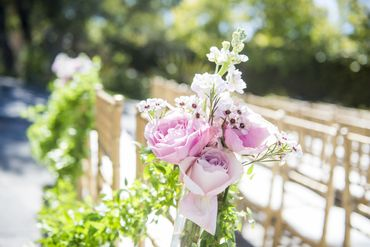Outdoor pink wedding floral decor