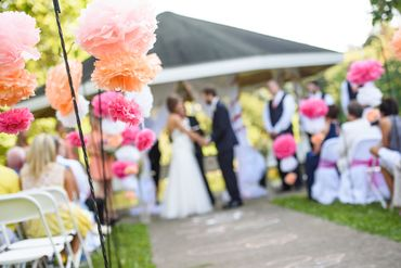 Outdoor orange wedding ceremony decor