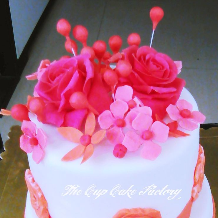 Small cake decorated with sugar flowers