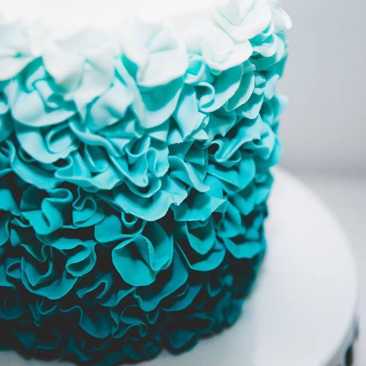 Teal ombre ruffle wedding cake