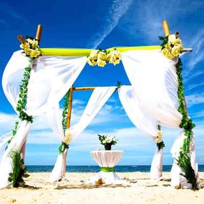 White beach wedding ceremony decor