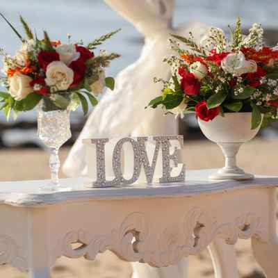 White beach wedding photo session decor