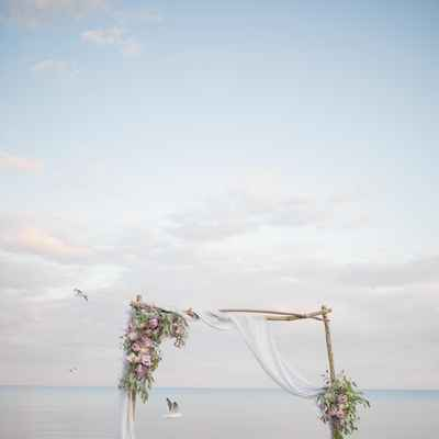 Blue beach wedding ceremony decor